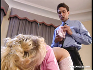 A couple of men are discussing business in the office and then Sophie Roche appears sucking on cock.