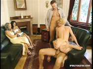Daniela chats with a man in the office before getting into a threesome with two guys while other girls watch.
