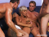 Brigitte starts the scene in true style by slowly thudding herself off and she gets ready for three fat cocks that she starts to blow on.